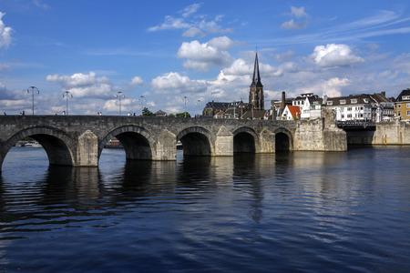 meuse: View of Maastricht city centre with its medieval bridge over the Meuse river. Maastricht is a town in the southeast of the Netherlands. It is the capital city of the province of Limburg.