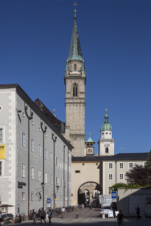 The spire of Franziskanerkirche in the historic center of the city of Salzburg in Austria. Salzburgs Old Town (Altstadt) is internationally renowned for its baroque architecture and is one of the best-preserved city centers north of the Alps.