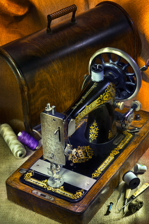 renamed: An antique Singer 12 Sewing Machine with gold decoration. The Singer Corporation is an American manufacturer of sewing machines, first established as I. M. Singer & Co. in 1851. Renamed Singer Manufacturing Company in 1865, then The Singer Company in 1963
