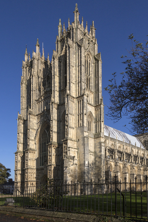 owes: Beverley Minster in the city of Beverley in the East Riding of Yorkshire in northeast England. This medieval Gothic Minster owes its origin and much of its importance to Saint John of Beverley, who founded a monastery here around 700 AD and whose bones st