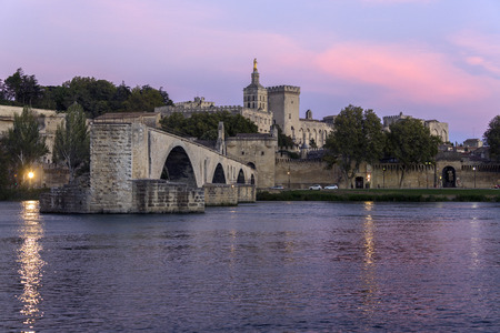 Dusk over the Pont dAvignon (Pont Saint-Benezet) and the city of Avignon in the department of Vaucluse on the left bank of the Rhone River. it was the residence of the popes during their exile from Rome. Between 1309 and 1377, seven successive popes resi