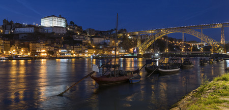 Night view of the city of Oporto (or Porto) in Portugal. Porto is one of the oldest European ports, and its historical centre was proclaimed a World Heritage Site by UNESCO in 1996. One of Portugals internationally famous exports, port wine, is named aft