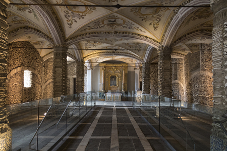 Capela dos Ossos or Chapel of Bones - is one of the best known monuments in Evora, Portugal. It is a small interior chapel located next to the entrance of the Church of St. Francis. The Chapel gets its name because the interior walls are covered and decor