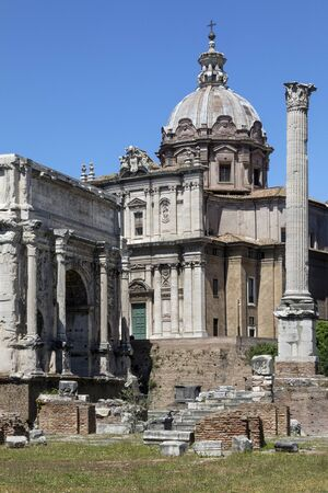 severus: The Roman Forum - Rome Italy. The Arch of Septimius Severus, the church of Santi Luca-e-Martina and the Column of Phocas. The arch is a triumphal arch dedicated in AD 203 to commemorate the Parthian victories of Emperor Septimius Severus and his two sons.