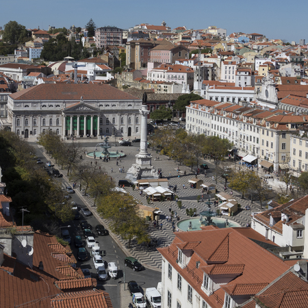 Rossio (Praca Dom Pedro IV) and the National Theater (Teatro Nacional Dona Maria II) in the city center of Lisbon in Portugal. Stock Photo - 81342502