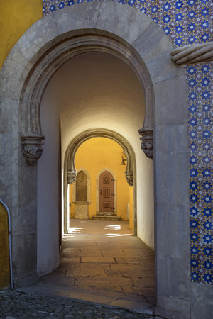 extensively: Doorway in the Pena National Palace at Sintra near Lisbon in Portugal. Originally built on the site of the Monastery of Nossa Senhora da Pena, it was renovated extensively by Ferdinand II of Portugal.