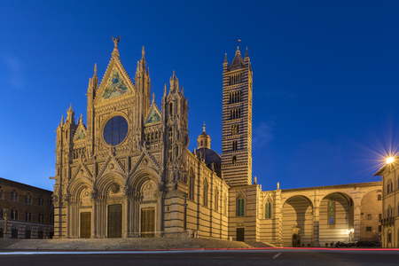 Siena - Italy. The 12th century Siena Cathedral (The Duomo) at dusk. A masterpiece of Italian Romanesque-Gothic architecture.
