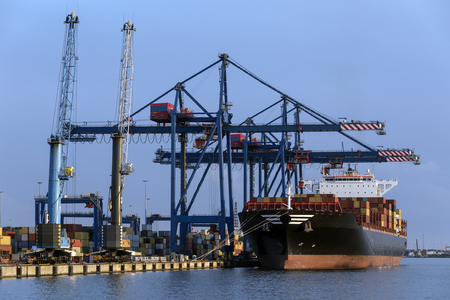 A large container ship unloading in the port of Klaipeda in Lithuania.
