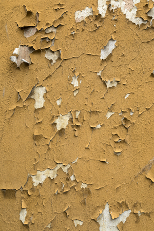 Old peeling paint on a wall in a derelict property in the city of Tallinn in Estonia.