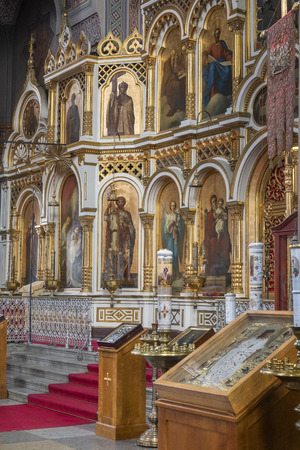 The iconostasis in Uspenski Cathedral in the city of Helsinki in Finland. The Cathedral is on a hillside on the Katajanokka peninsula overlooking Helsinki. Designed by the Russian architect Aleksey Gornostayev (1808–1862), it was completed in 1868 after