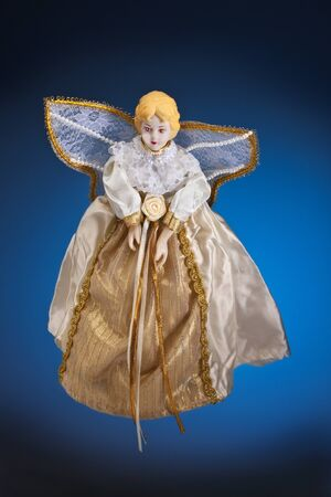 A Christmas Angel - An angel is a spiritual being believed to act as an attendant, agent, or messenger of God, conventionally represented in human form with wings and a long robe