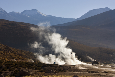 Geysers and geothermal steam vents at the El Tatio Geyser Field at an altitude of 4500m (14764ft) in the Atacama Desert in northern Chile. Stock Photo