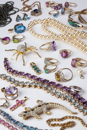 A collection of rings and other jewelry including diamonds, ruby, emeralds, garnets, amthyst etc.