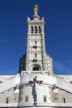 The Cathedral de Notre-Dame-de-la-Garde high on a hill overlooking the city of Marseille in the South of France. Built between 1853 and 1864 this Neo-Byzantine Basilica has a bell tower 151ft (46m) high capped with a gilded statue of the Virgin Mary. Stock Photo
