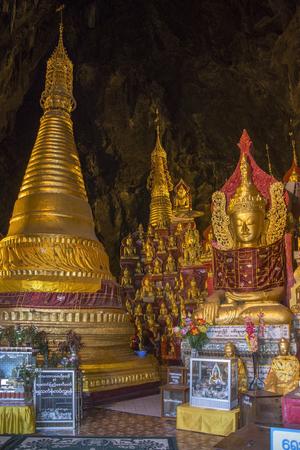 Imagens de Buddha na caverna de Pindaya em Myanmar (Burma). O interior do templo da caverna contém mais de 8000 imagens de Buda, as mais antigas são pensadas para cerca de 1750. Foto de archivo - 92385381