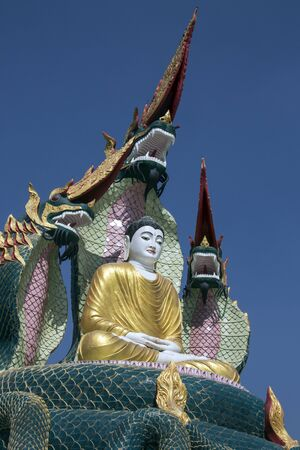 A Buddha Image protected by Nagas (mythical dragon-like creatures) near Monywa in Myanmar (Burma). Stock Photo