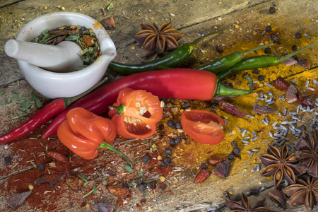 Hot Chili Peppers - Herbs and Spices on a rustic farmhouse table. Stock Photo