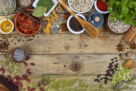 Selection of Herbs and Spices used in cooking to add flavor and seasoning - Space for text. Stock Photo