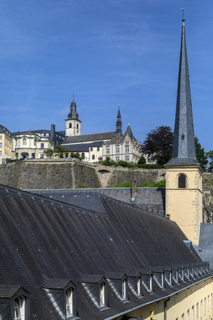 Luxembourg City - Ville de Luxembourg. The walls of the old town viewed from the Grund area of the city. Stock Photo