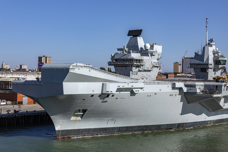HMS Queen Elizabeth - Royal Navy of the United Kingdom. Capable of carrying up to 60 aircraft. Queen Elizabeth has no catapults or arrestor wires and is instead designed to operate V/STOL aircraft and Merlin helicopters. Editorial