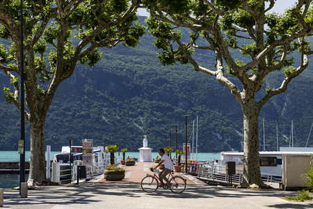 The tree lined Boulevard Du Lac at the Grand Port in the town of Aix les Bains in the Auvergne-Rhone-Alpes region in south-eastern France. On the eastern shore of Lake Bourget (Lac du Bourget or Lac d Aix).