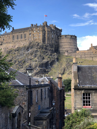 Edinburgh Castle is an historic fortress which dominates the skyline of the city of Edinburgh, Scotland, from its position on the Castle Rock.