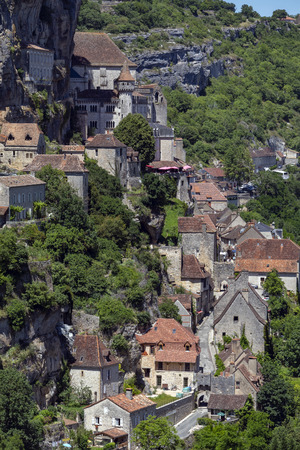 Rocamadour in the Lot department of southwestern France. Rocamadour has attracted visitors for its setting in a gorge above a tributary of the River Dordogne, and for its sanctuary of the Blessed Virgin Mary, which for centuries has attracted pilgrims from many countries. Stock Photo