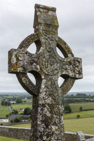 A Celtic Cross at the Rock of Cashel, an historic site near the village of Cashel in County Tipperary in the Republic of Ireland.