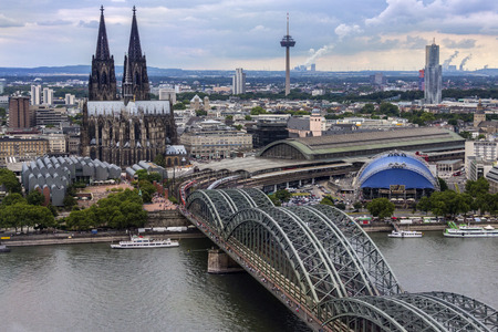 The Hohenzollern Bridge and Cologne Cathedral in the industrial and university city of Cologne situated on the River Rhine in Germany.