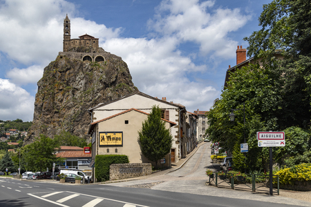The Chapel of St Michel-dAiguilhe in the city of Le Puy-en-Velay in the Auvergne-Rhone-Alpes region of France. Built in 969 on a volcanic plug 85m (279 ft) high. The chapel is reached by 268 steps carved into the rock.