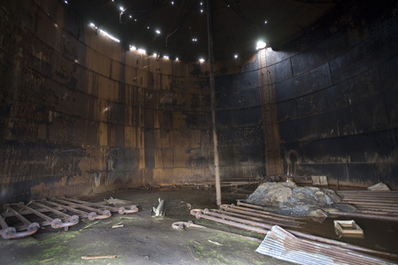 Inside the rusting remains of a metal tank at an old abandoned whaling station on Deception Island in Antarctica. Stock Photo