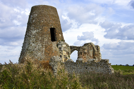 Ruins of St Benet Monastery at Holm near Howe on the Norfolk Broads in southeast England. The Monastery was founded before the Norman conquest, however the walls of this ruin only date from the 14th Century. The tower is the remains of a windmill built onto the ruins in the 18th Century. The monastery was abandoned in 1545.