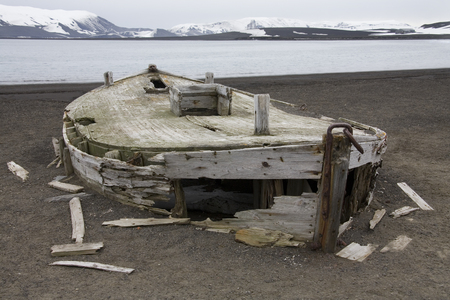 Old wooden boats near the abandoned whaling station on Deception Island in Antarctica.