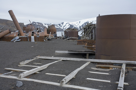Rusting remains of an abandoned whaling station on Deception Island in Antarctica.