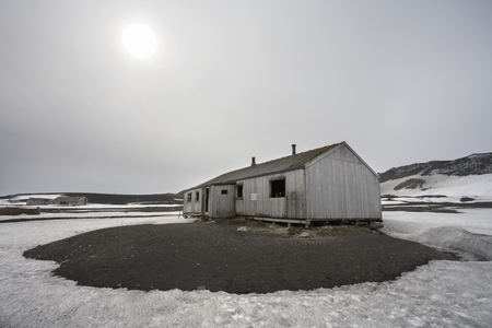 Abandoned wooden huts at the old whaling station on Deception Island in Antarctica.