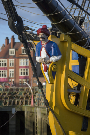Ships figurehead in the harbor of Whitby on the North Yorkshire Coast in northern England. Editorial