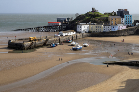 Tenby harbor in Carmarthen Bay at low tide - Tenby in Pembrokeshire, south Wales in the United Kingdom.