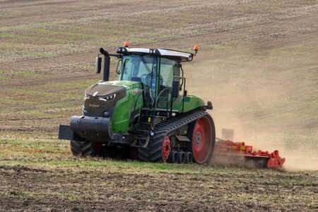 Malton. UK. 09.22.19. Tractor pulling a Ridged Roller (UK) or  Cultipacker (USA) on a field in North Yorkshire in the United Kingdom. Roller is use to break up large clods of earth prior to seeding.