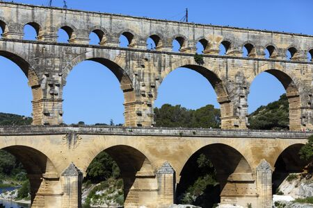 Pont du Gard. France.   Ancient Roman aqueduct built in the first century AD. It crosses the Gardon River near the town of Vers-Pont-du-Gard in southern France. UNESCO World Heritage Site.