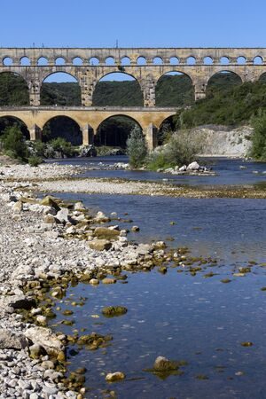 Ancient Roman aqueduct built in the first century AD. It crosses the Gardon River near the town of Vers-Pont-du-Gard in southern France. UNESCO World Heritage Site.