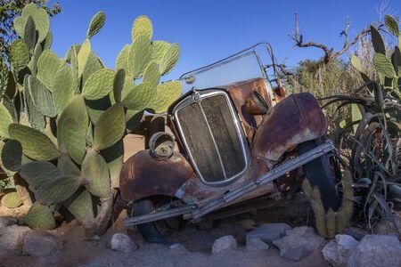 An old Morris Eight motor car abandoned and rusting away in Namib Desert near Twyfelfontein in the Namib Desert in Namibia, Africa.