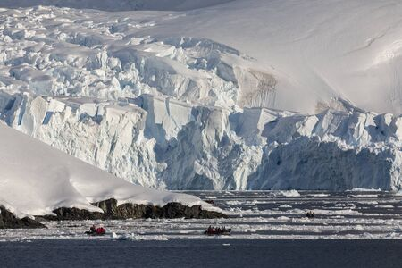 Adventure tourists in Paradise Bay on the Antarctic Peninsula in Antarctica. Reklamní fotografie
