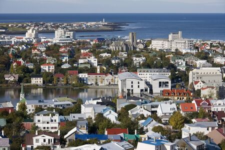 Overview of central Reykjavik, Iceland. The building with curved roofs is the home of the Icelandic Parliament, the Alpingishusid.