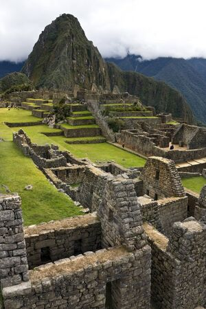 Machu Picchu. Peru. 04.20.08. The Inca city of Machu Picchu in Peru. Although known locally, it was not known to the Spanish during the colonial period and was unknown to the outside world until American historian Hiram Bingham brought it to international attention in 1911. Foto de archivo