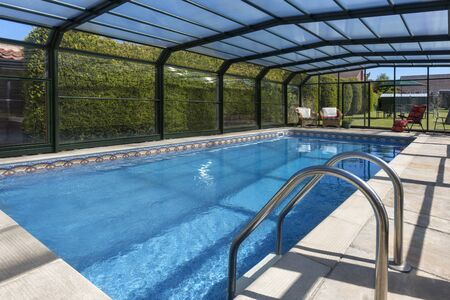 Slingsby. England. 06.08.13. Swimming pool in the garden of a large country property in Yorkshire, England.