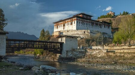 Rinpung Dzong and Nemi Zam Bridge - a large Buddhist monastery and fortress of the Drukpa Lineage of the Kagyu school near Paro in the Kingdom of Bhutan.