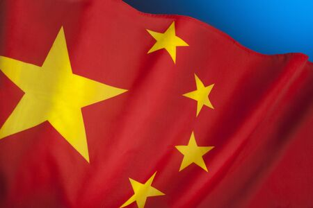 Flag of The Peoples Republic of China. The red represents the communist revolution; the five stars and their relationship represent the unity of the Chinese people under the leadership of the Communist Party of China.