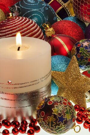 Christmas candle, baubles and decorations