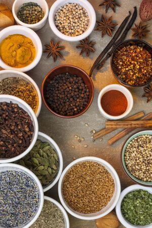 A selection of spices used in cooking - cinnamon, lavender, cardamon, chilli, star anise, peppers, turmeric, dill, vanilla etc.
