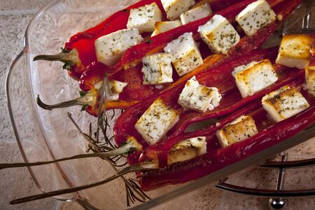 Greek Feta Cheese baked with herbs in Sweet Peppers